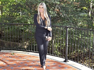 Stephany Bowman, wearing a black nursing jumpsuit from Bumpstyle Box