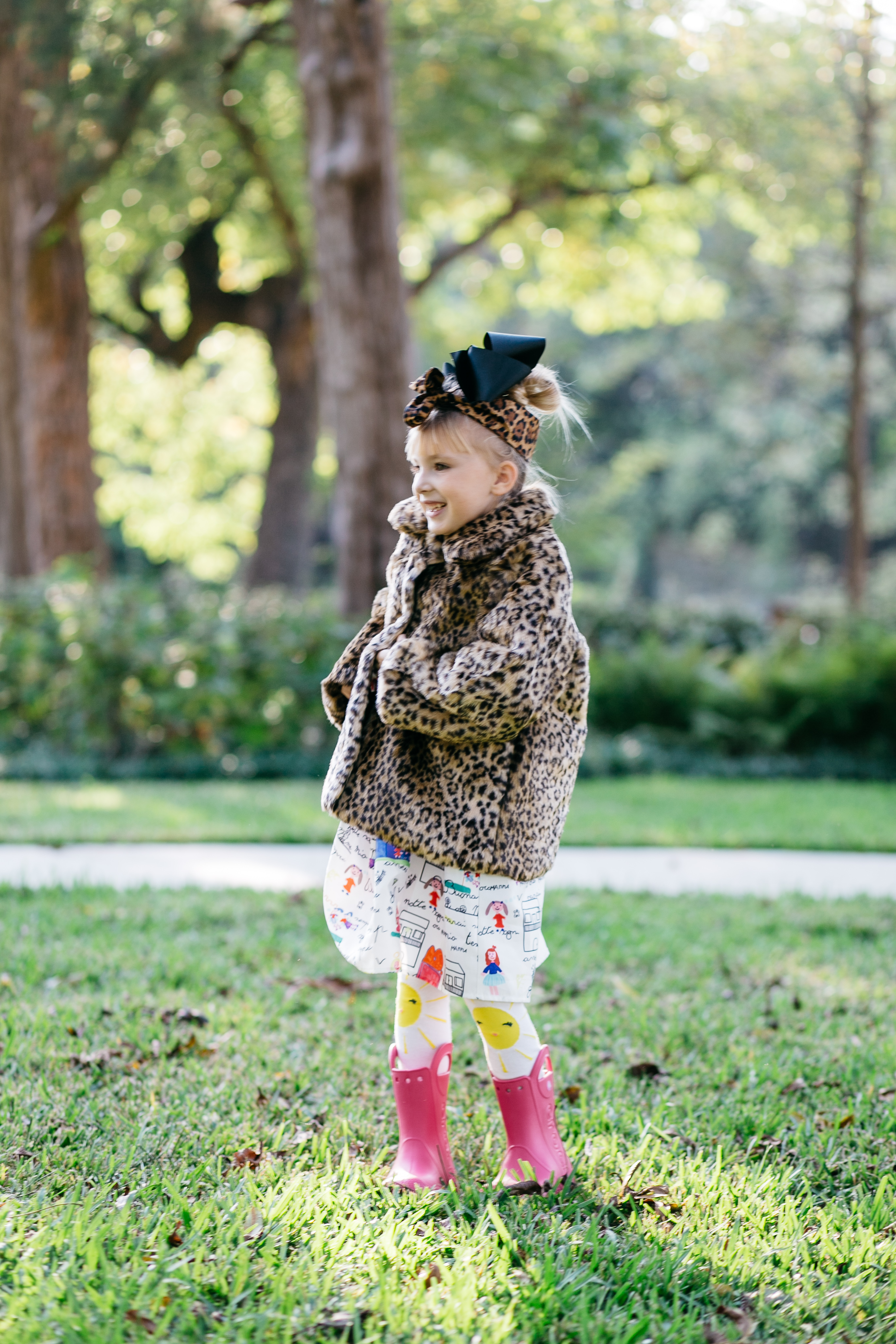 Annabelle Bowman wearing aOshKosh B'gosh Faux fur coat and Croc Rainboots
