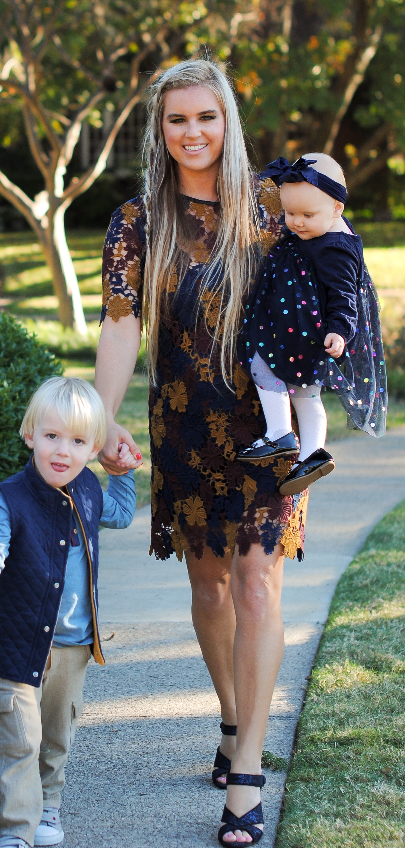Alexander Bowman wearing Colored Organics vest and shirt. Stephany Bowman in a lace Nordstrom dress and Angelina Bowman GAP