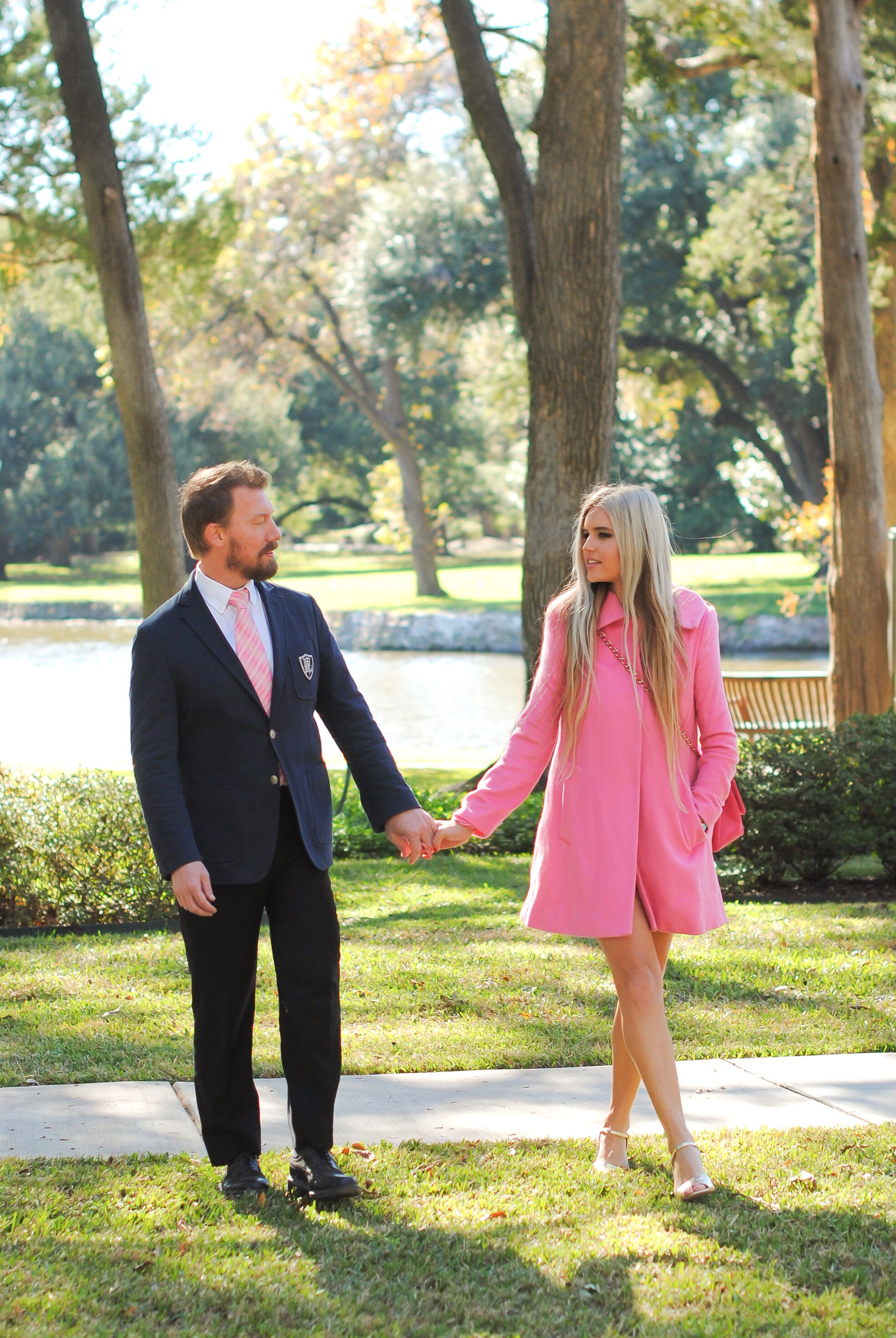 Michael Bowman wearing an Eden Park suit and Viivienne Westwood Tie. Stephany Bowman in a Pink Tartan coat, Topshop shoes, and pink Chanel handbag
