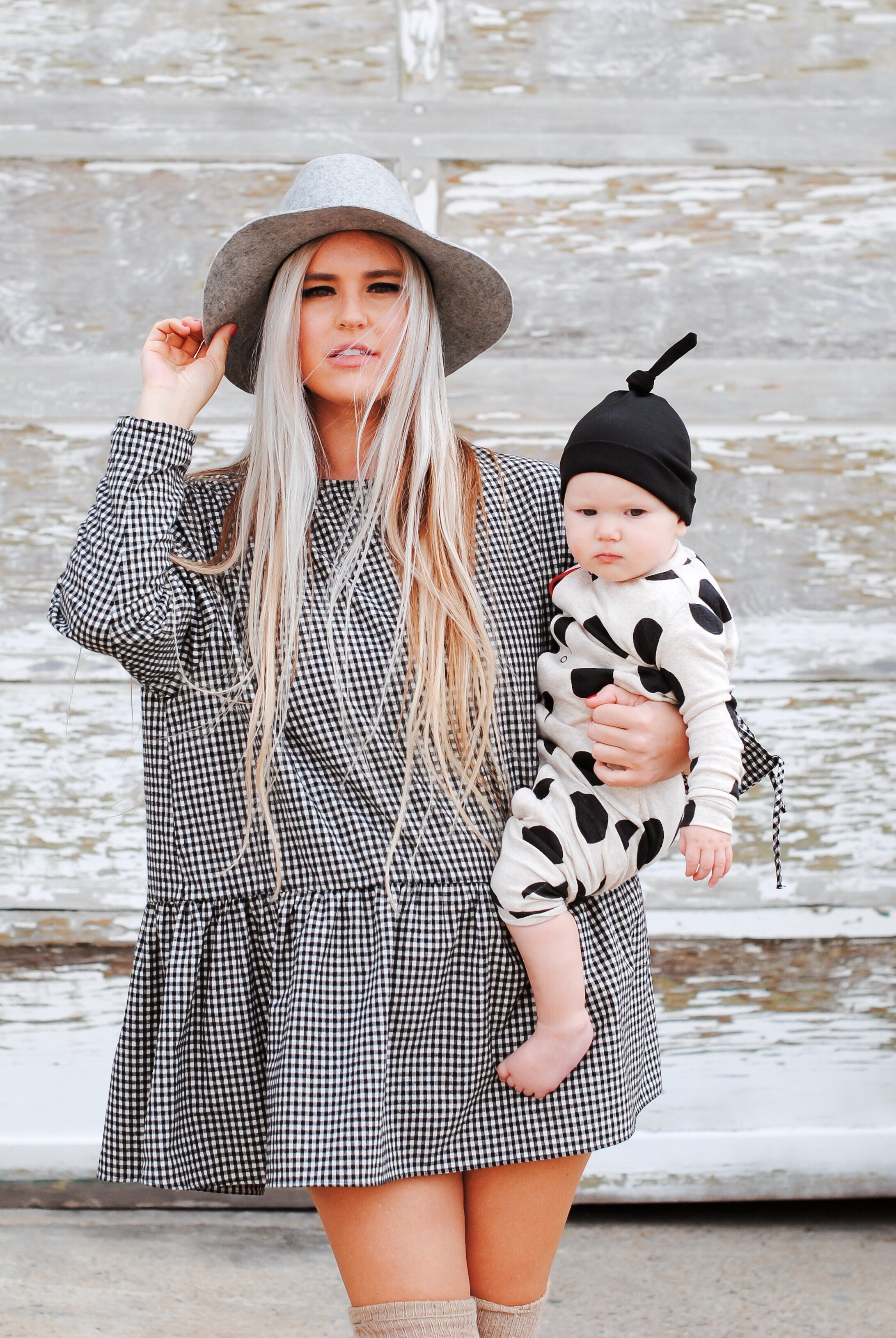 Stephany Bowman from Stephany's Choice wearing Zara black and white smocked dress, over the knee cream knit socks from Free People and Black Mary Jane heels from Topshop. Fedora is from Target. Baby Angelina Bowman is wearing Colored Orangics from head to toe