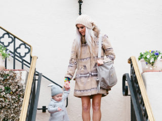 Stephany Bowman, Editor of Stephany's Choice, wearing a Fawn Design light grey diaper bag, ZARA booties, coat from Nordstrom and Hat from PRIMARK. Angelina Bowman wearing a Little White Company cashmere sweater, silver shoes from Target and bunny hat from Zulily