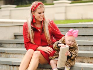 Stephany Bowman, Editor of Stephany's Choice is wearing a red wool Fleurette coat from Nordstrom, Black shoes from Aldo, headband from Antrhopologie, red tassel earrings from H&M and a silver sparkle clutch from Aldo. Angelina Bowman is wearing a faux fur coat from OshKosh.