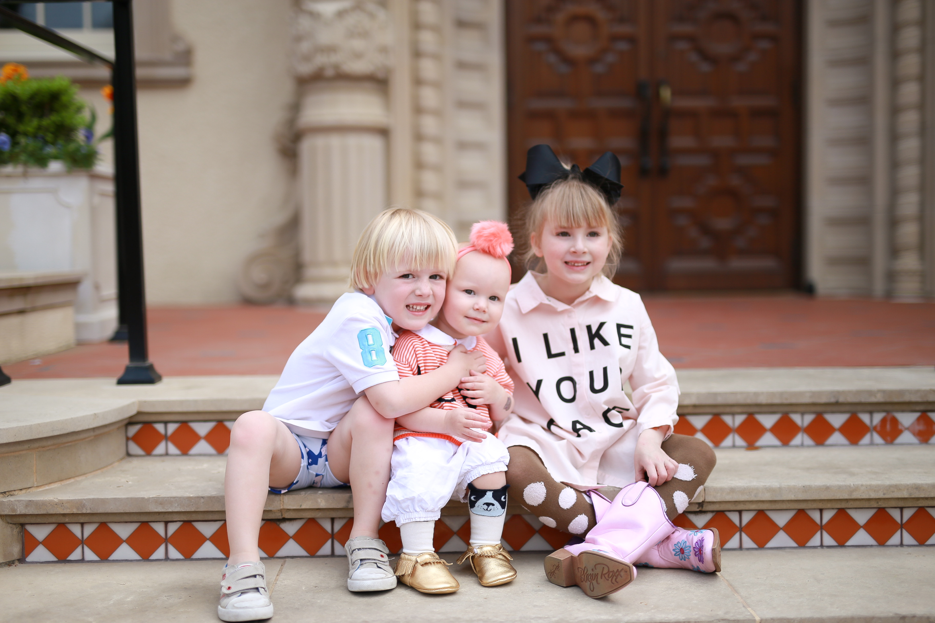 Alexander, Annabelle, and Angelina wearing Ollie and Mae