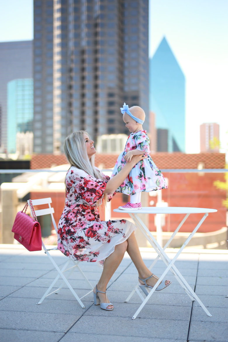 Stephany Bowman, Editor of Stephany's Choice wearing a knee length floral dress from StyleWe, pink Chanel purse. Angelina Bowman wearing Blue headband from Claire's Accessories and Pink sneakers from Keds