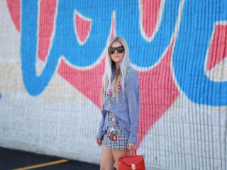 Stephany Bowman, Editor of Stephany's Choice wearing ZARA gingham top and shorts, navy high heels and red mini lady bag. Cat Eye Sunglasses from Henri Bendel
