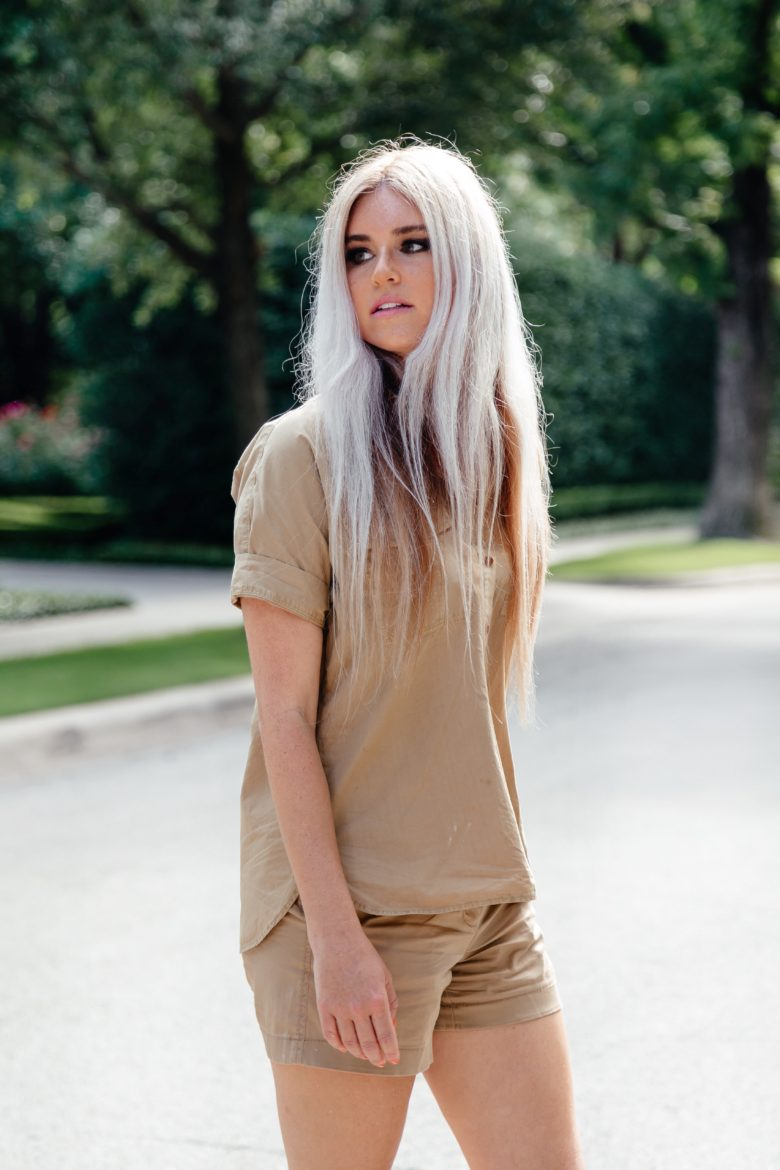 Stephany Bowman wearing JCrew kaki top and shorts and Aldo white sneakers