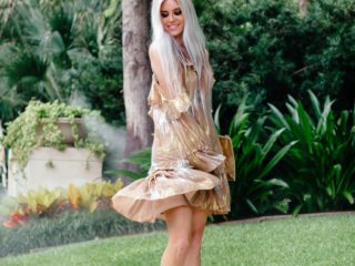 "Stephany Bowman wearing You and Me Mini Dress"" from Free People and heels from Aldo"