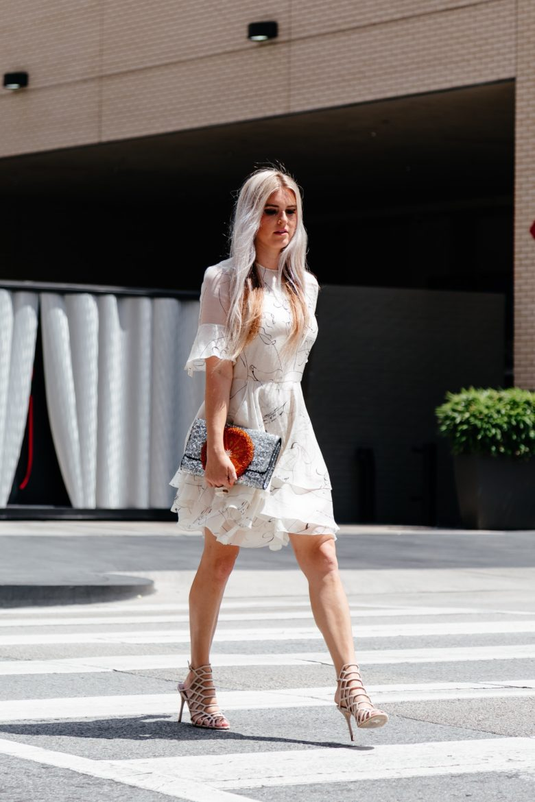 Stephany Bowman in a layered white with black detail H&M dress, Steve Madden heels and Sarahs Bags Clutch