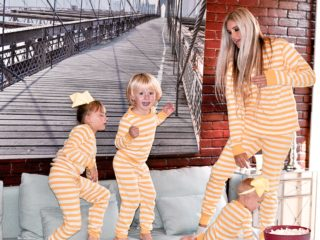 Stephany Bowman Editor of Stephany's Choice and all three of her kids wearing matching Hanna Anderson Yellow striped pjs