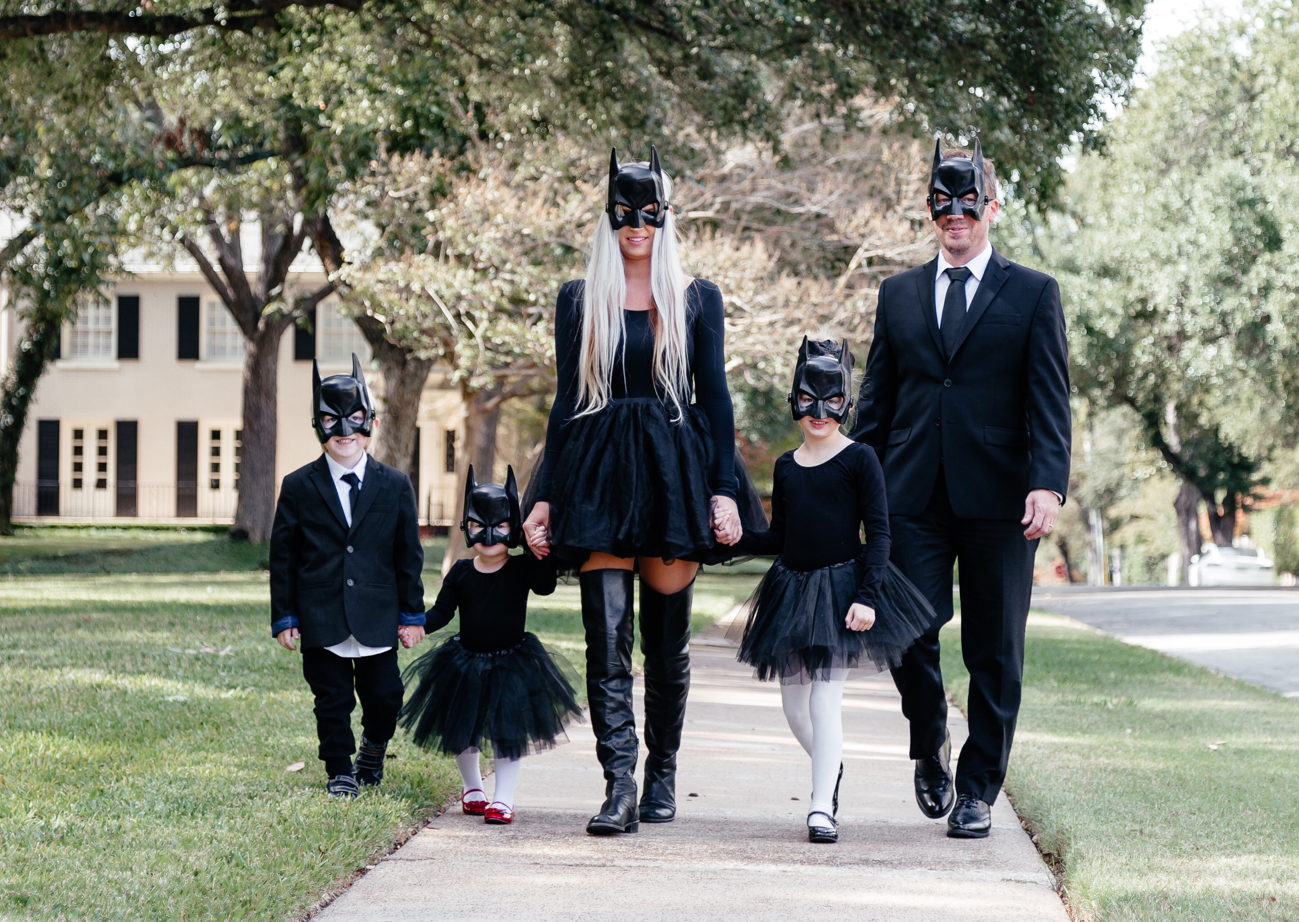 Stephany BOWMAN editor of Stephany's Choice wears black and white Batman themed halloween costume with the whole family