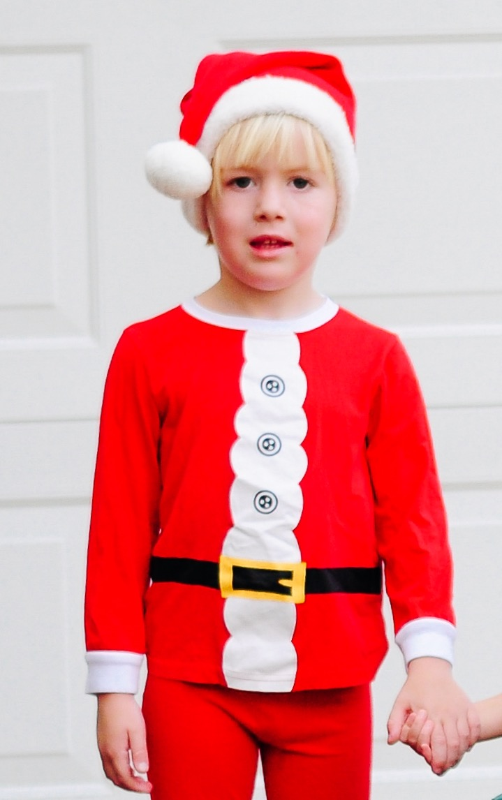 Alexander Bowman in a Santa pajama from Carter's, Santa hat from Hanna Andersson, Nike sneakers from Nordstrom