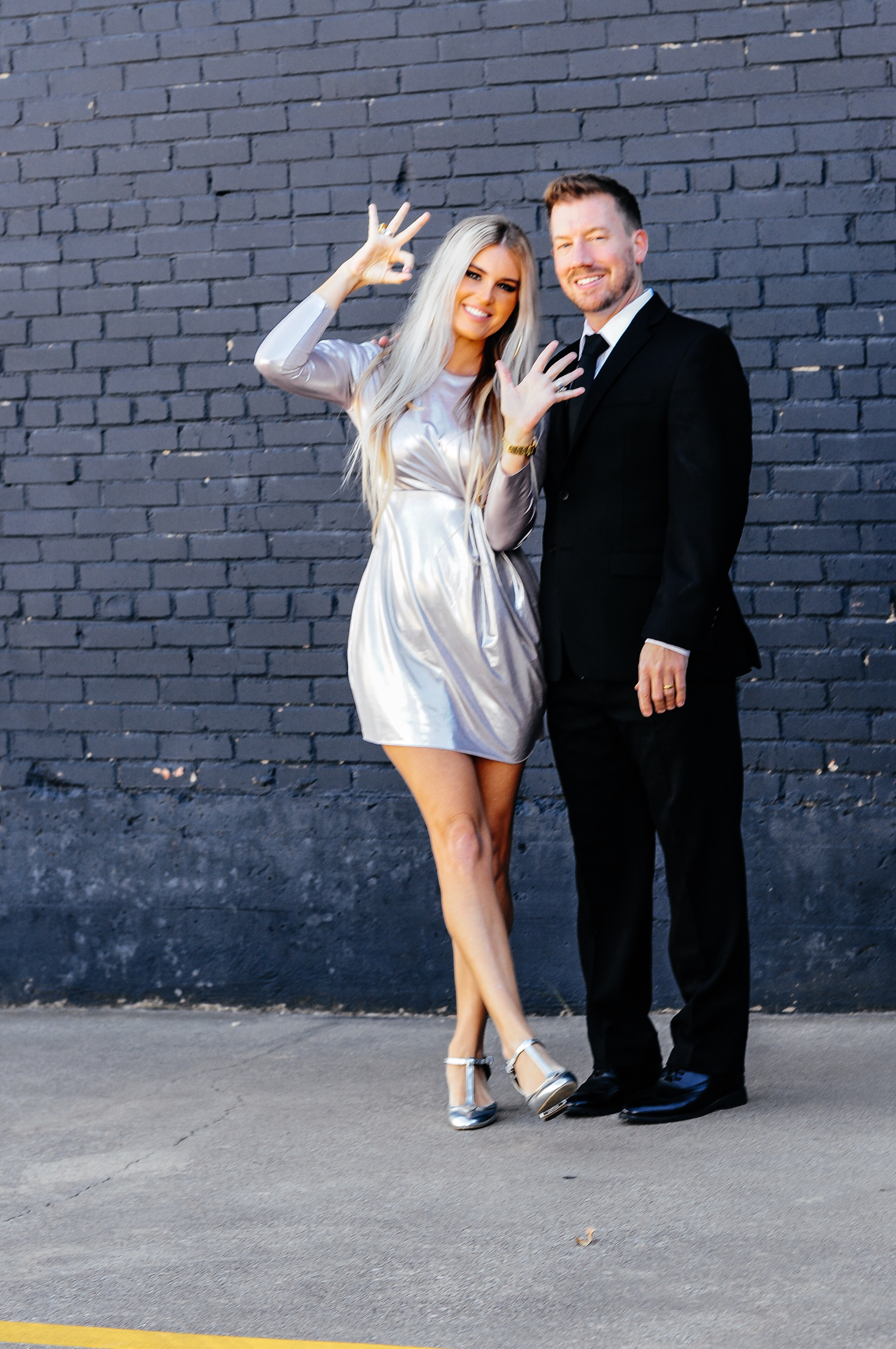 Stephany Bowman, Editor of Stephany's Choice wearing a silver metallic ZARA dress from the Fall/ Winter 2017 collection, TopShop silver heels. Michael Bowman wearing black suit , tie, white shirt and shoes from Nordstrom