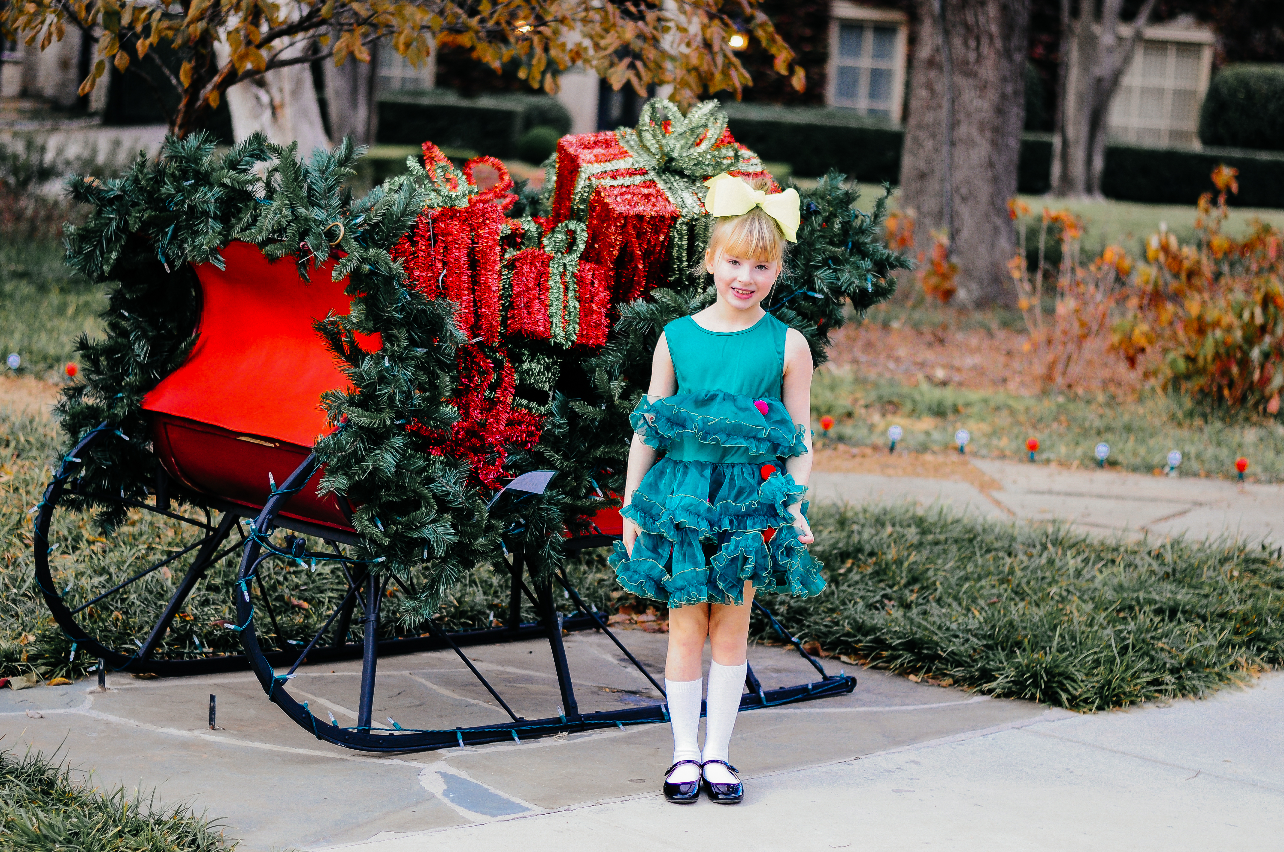 Annabelle Bowman in a Christmas tree dress from H&M