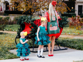 Stephany Bowman in a Target holiday outfit, Claire's headband, Alexander Bowman in a Santa pajama from Carter's, Santa hat from Hanna Andersson, Nike sneakers from Nordstrom, Annabelle and Angelina Bowman in matching Christmas tree dresses from H&M