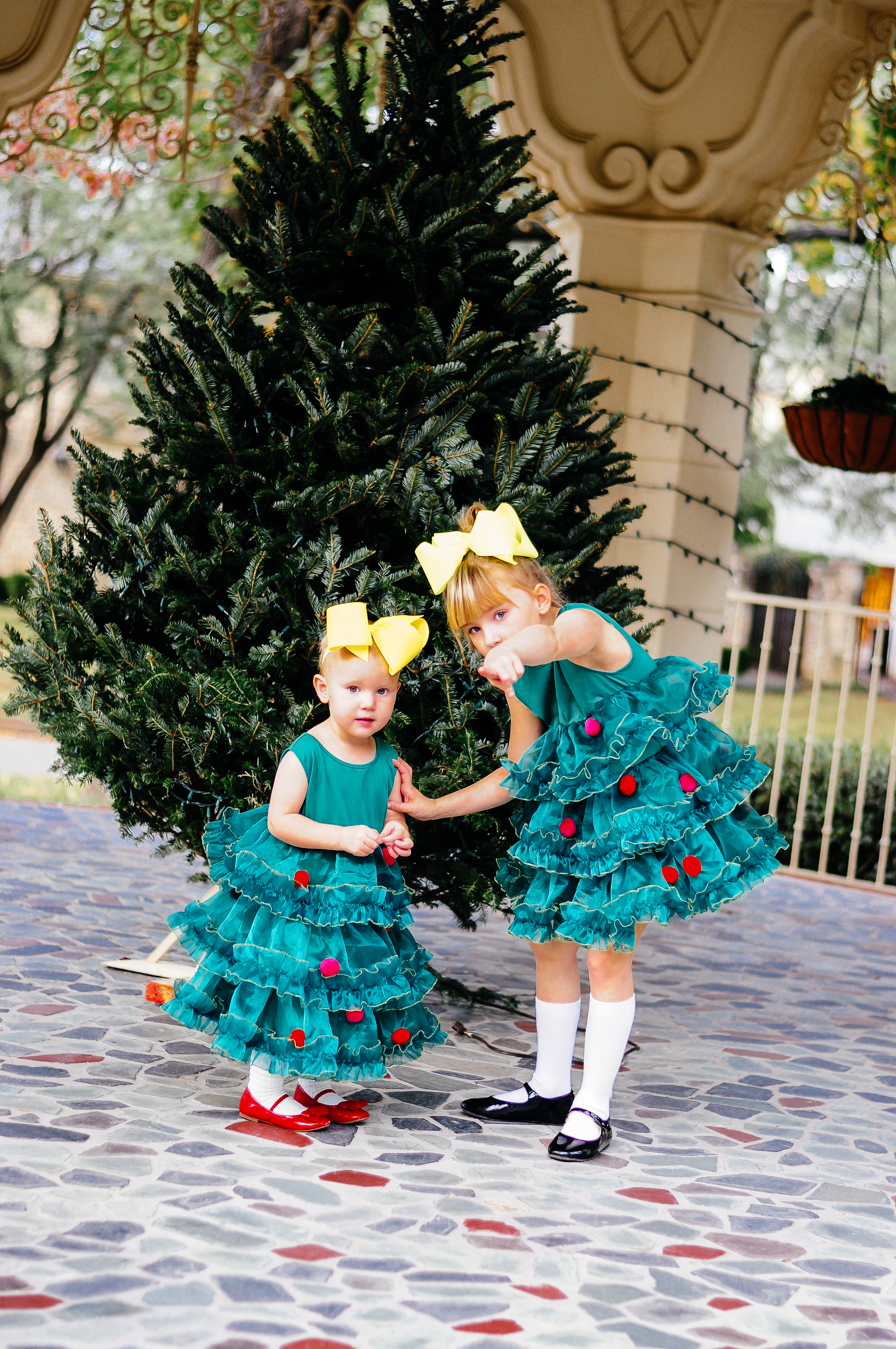 Annabelle and Angelina Bowman in a Christmas tree dress from H&M