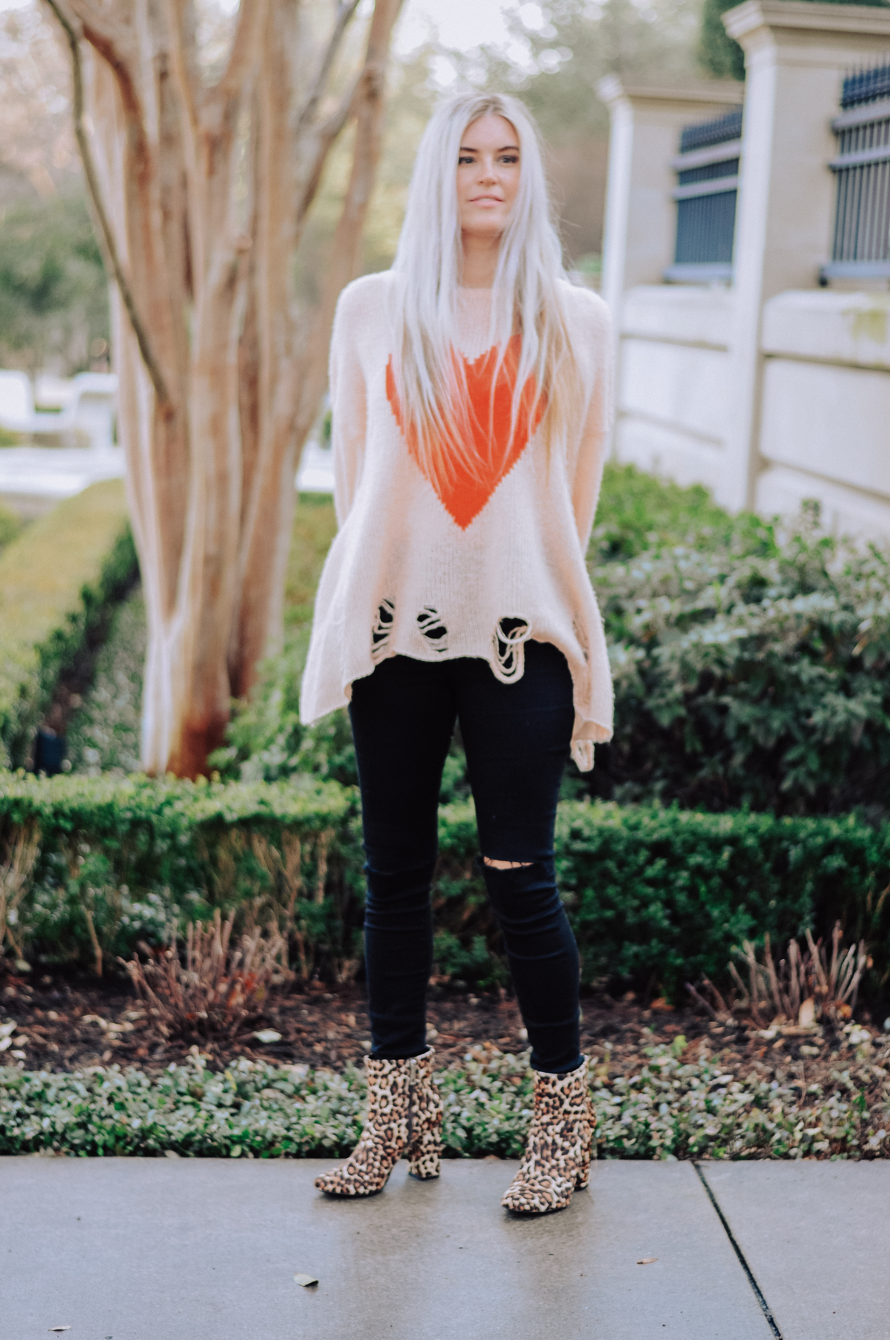Stephany Bowman, wearing WILDFOX sweater, BOW AND MOT skinny jeans and CHARLES DAVID calf leopard booties