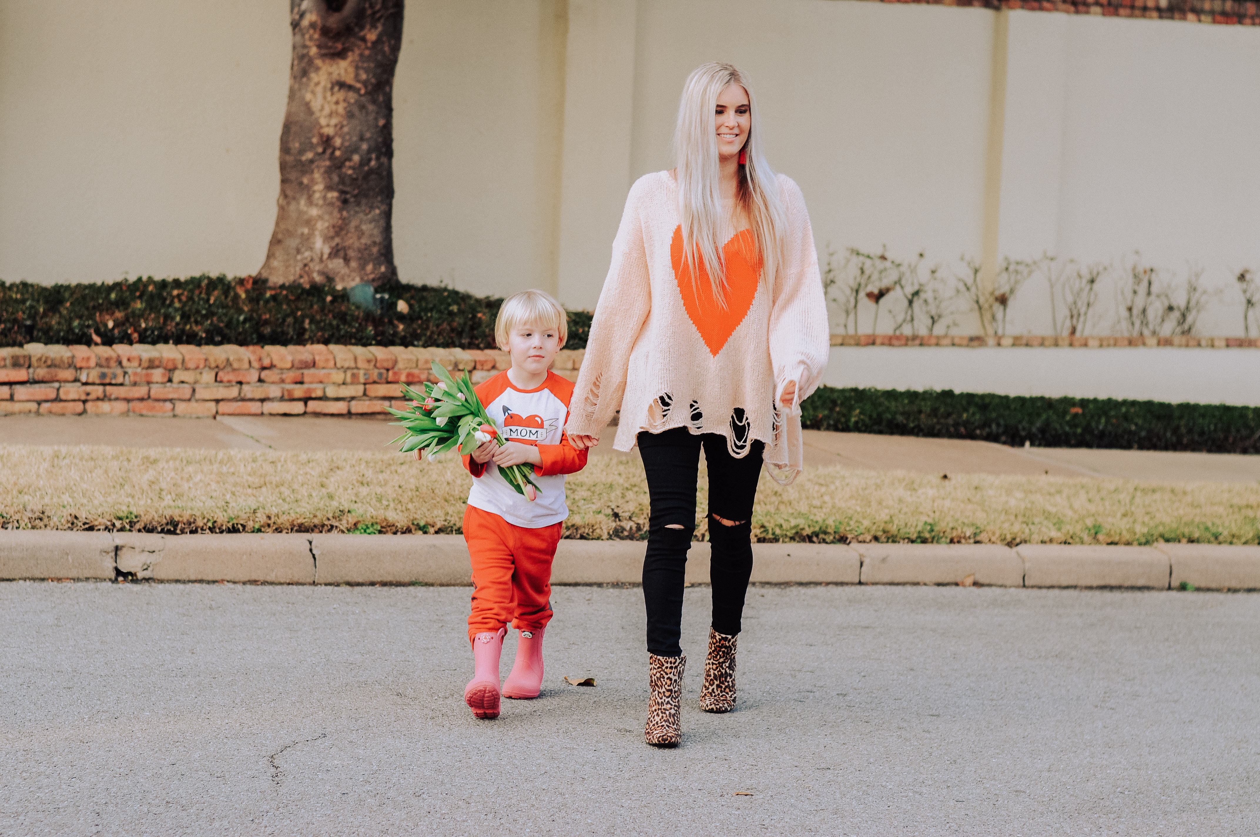 Stephany Bowman wearing heart sweater from WILDFOX, black skinny jeans from MOTT AND BOW, and Cheetah booties from Nordstrom Rack. Alexander Bowman, in Gymboree shirt, Gap sweats and Crocs